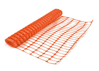 Orange warning barrier fence with oval mesh opening.lastic mesh  38 × 38mm