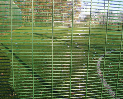 Green powder coated anti-climb 358 fence encloses football court
