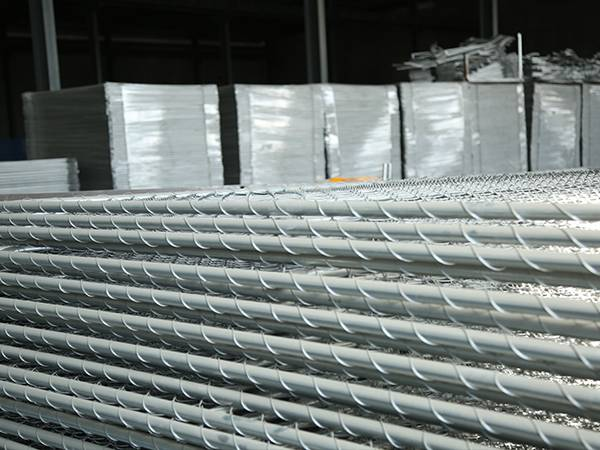 There are a lot of packed galvanized temporary chain link fence.