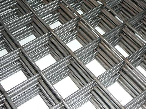 Welded bar concrete reinforcing mesh sheets with 200 mm square mesh size.
