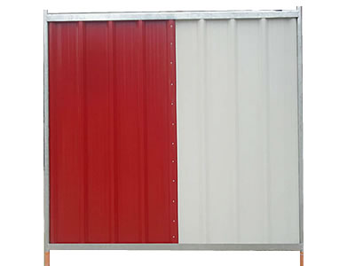 A red and a white corrugated sheet make up a hoarding panel.